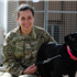 Charlotte Archer, 24, from Melton Mowbray with her black Labrador named Fire, at the dog kennels on Camp Bastion in Afghanistan. The kennels at Camp Bastion are equipped with a vet's surgery complete with operating theatre, as well as a pool for cooling